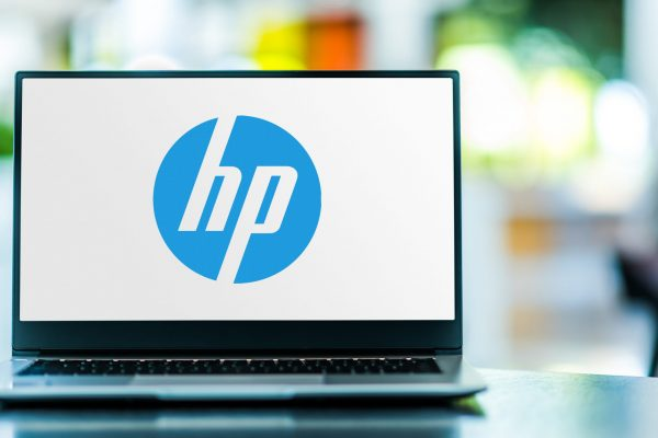 POZNAN, POL - FEB 6, 2021: Laptop computer displaying logo of HP, a multinational information technology company headquartered in Palo Alto, California
