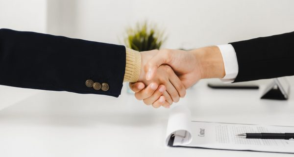 Successful negotiating and business deal, close up handshaking, happy with enjoying with workmate and partner, unity handshake concept