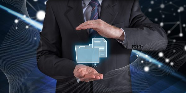 Data protection concept with businessman in a protective gesture